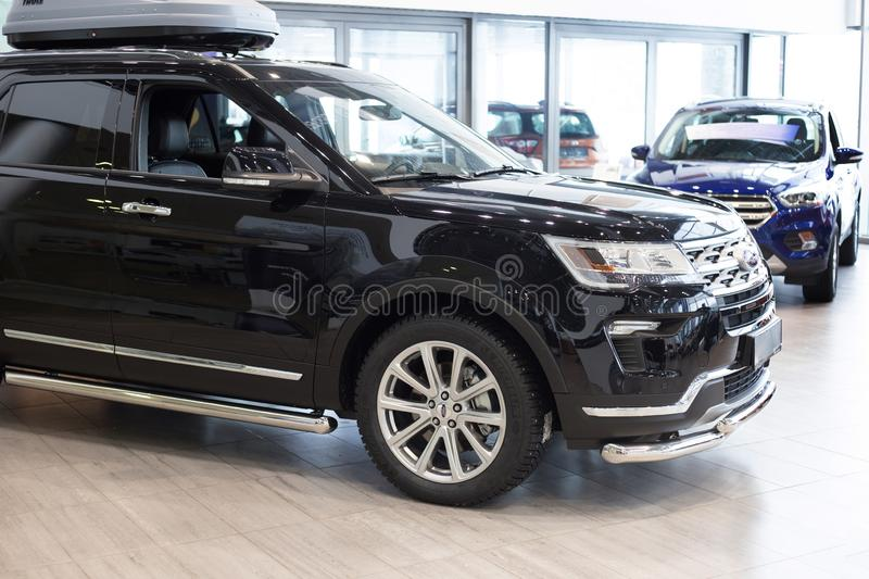 Russia, Izhevsk - January 27, 2019: Showroom Ford. New cars at dealer showroom. Prestigious vehicles. The famous world brand was founded by Henry Ford on 1903 royalty free stock photos