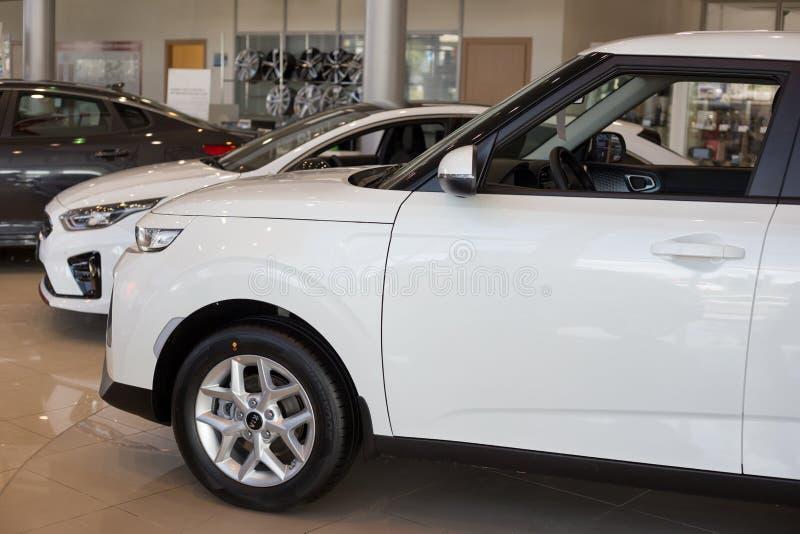 Russia, Izhevsk - July 4, 2019: New cars in the KIA showroom. Famous world brand. Prestigious vehicles royalty free stock photo