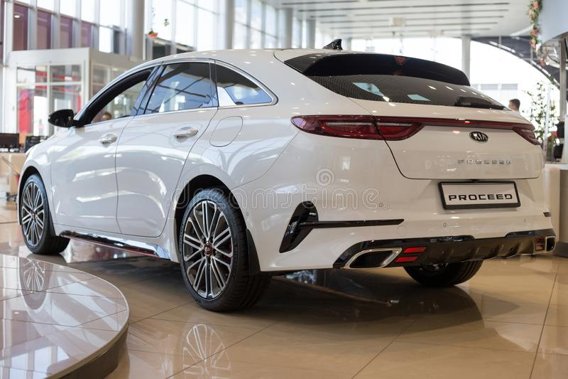 Russia, Izhevsk - July 4, 2019: New cars in the KIA showroom. Modern KIA ProCeed. Back view. Famous world brand royalty free stock image