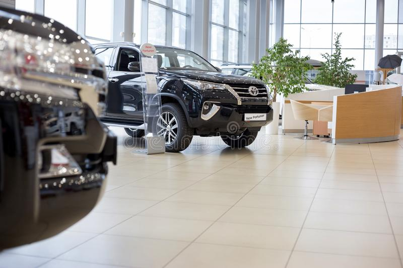 Russia, Izhevsk - October 20, 2018: Showroom Toyota. New Toyota Fortuner in dealer showroom. Modern transportation. Prestigious vehicles royalty free stock photo