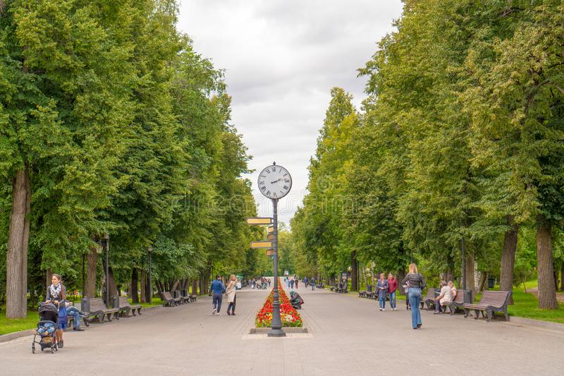 Russia, Kazan - August 8, 2019: Crowd of anonymous people walking through Central Park forest landscape. mockup royalty free stock images