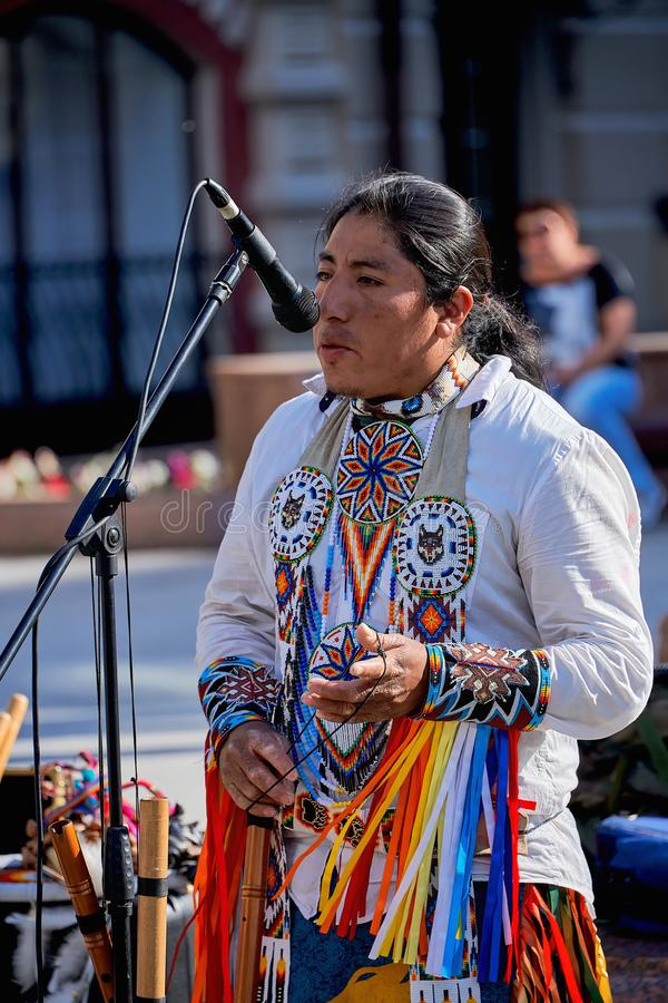Russia, Kazan June 2019. Native American traditional Indian musician performing on the street in national costume stock photography