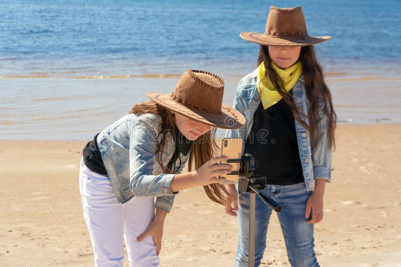 Russia, Kazan - May 25, 2019: Two teen girls take a selfie on iPhone Xs on a sunny day royalty free stock images
