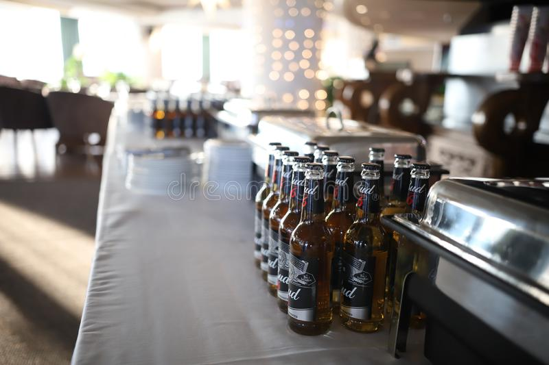 RUSSIA, KAZAN. 09-04-2019: Modern loft bar style. Bottles of beer on the stand royalty free stock photo