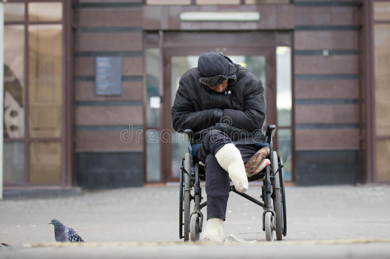Russia, Kazan 14 september 2016, dowmtown - Disabled homeless man on a wheelchair begging for money - drunk beggar stock photos