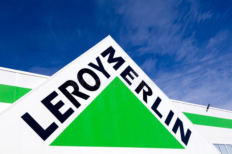 Russia Kemerovo 2019-04-02 Leroy Merlin brand sign against blue sky. French home-improvement, building tools, gardening retailer. Serving thirteen countries stock image