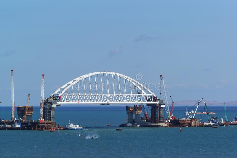 Construction of road and railway bridges across the Kerch Strait. The arched span of the railway bridge over the navigable part of. Russia, the Kerch Strait royalty free stock photography
