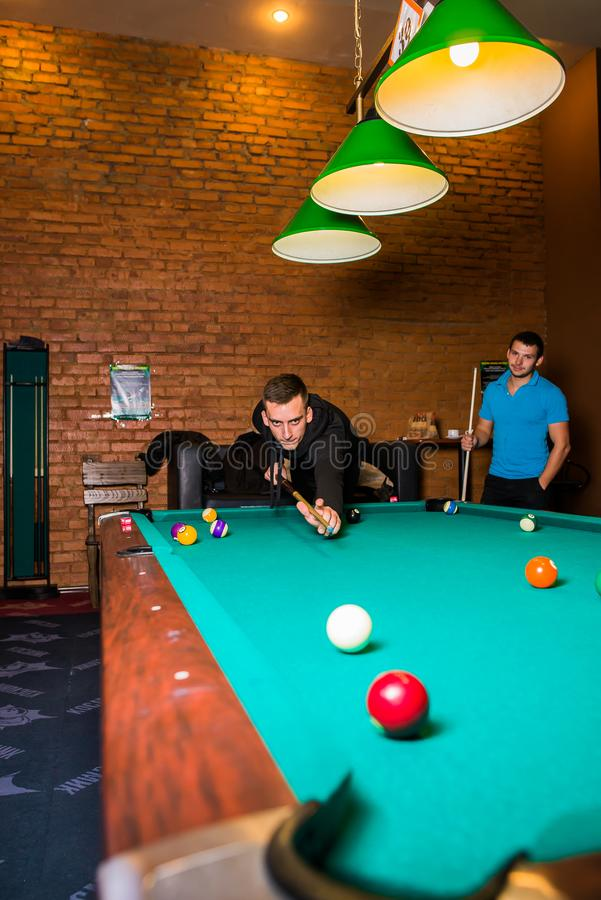 Russia,Krasnodar 19 November 2018-a man playing Billiards in the shopping center royalty free stock photos