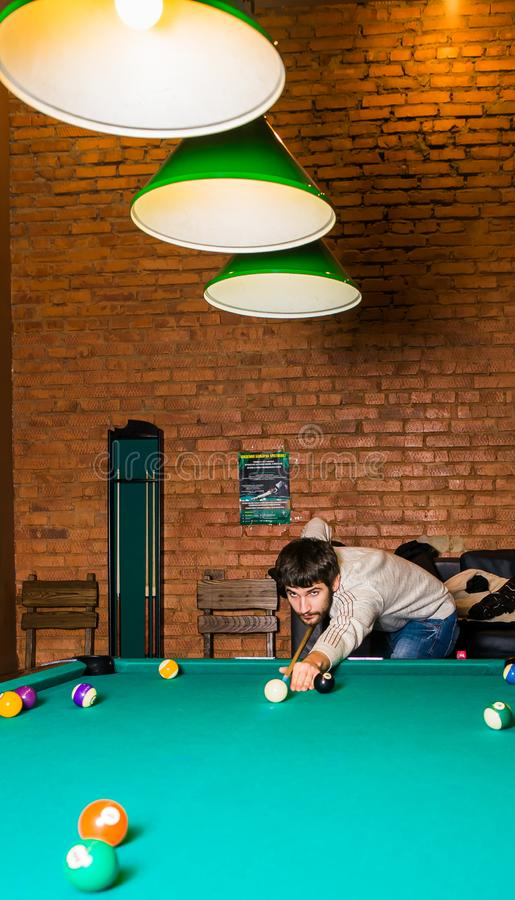 Russia,Krasnodar 19 November 2018-a man playing Billiards in the shopping center stock photography