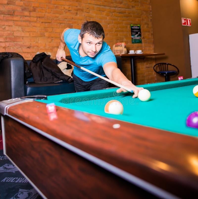 Russia,Krasnodar 19 November 2018-a man playing Billiards in the shopping center royalty free stock image