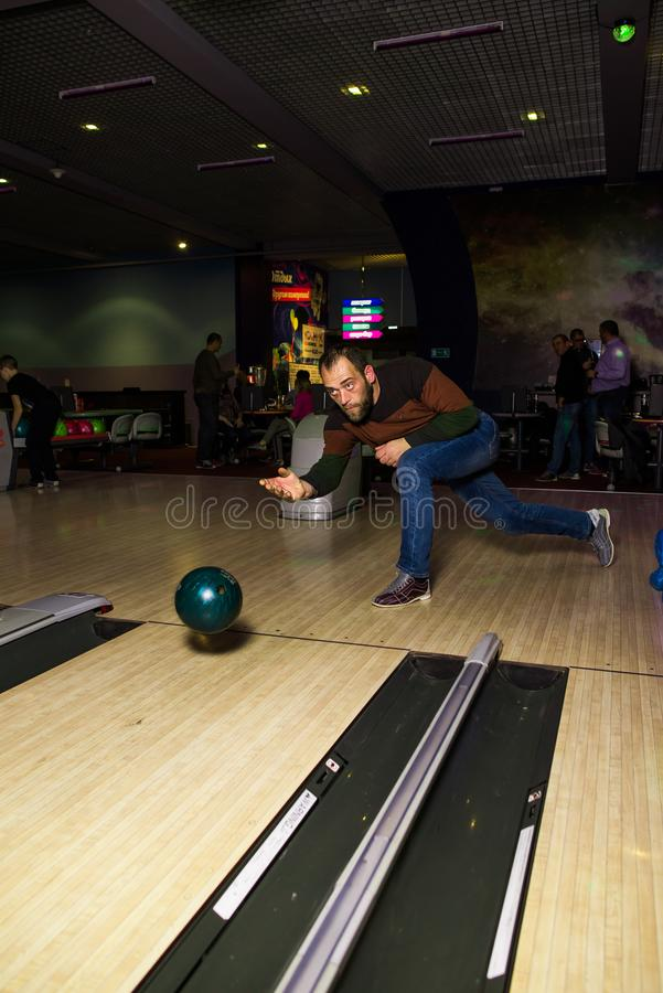 Russia,Krasnodar 19 November 2018-a man playing bowling in the shopping and entertainment center royalty free stock photo