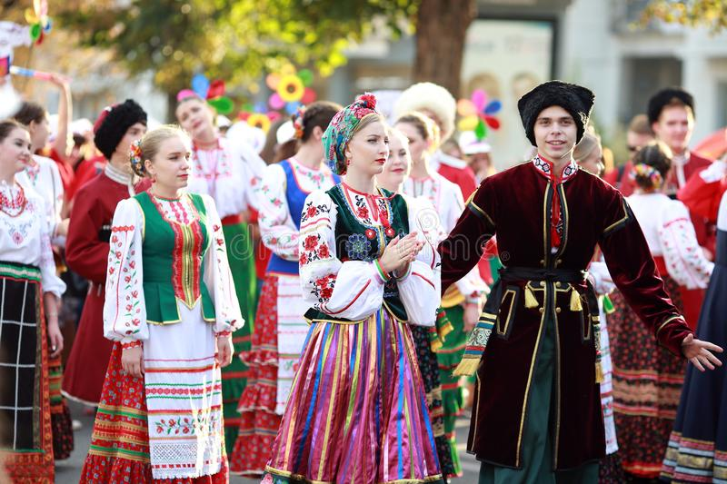 Procession of students of the Institute of culture, dancers in Cossack traditional dress, colored skirt, green trousers and maroon. Russia, Krasnodar 23.09.17 royalty free stock photos