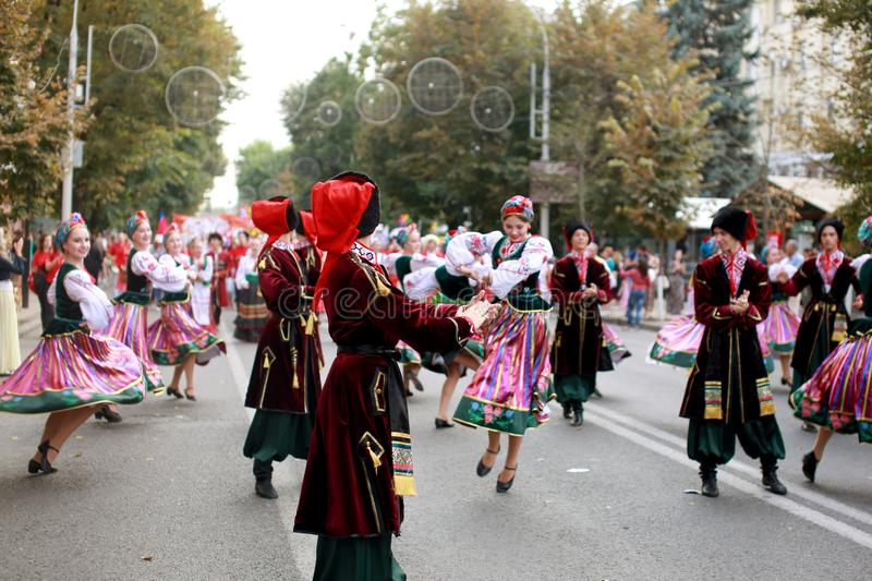Procession of students of the Institute of culture, dancers in Cossack traditional dress, colored skirt, green trousers and maroon. Russia, Krasnodar 23.09.17 royalty free stock image
