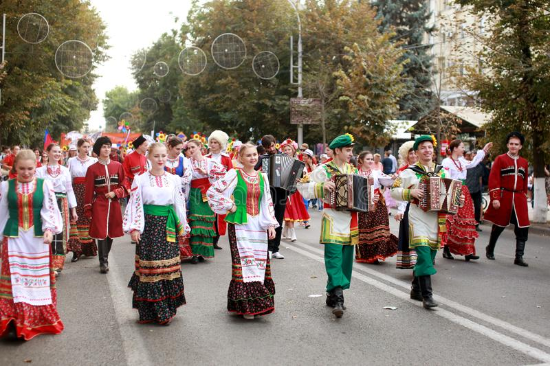 Procession of students of the Institute of culture, dancers in Cossack traditional dress, colored skirt, green trousers and maroon. Russia, Krasnodar 23.09.17 royalty free stock images
