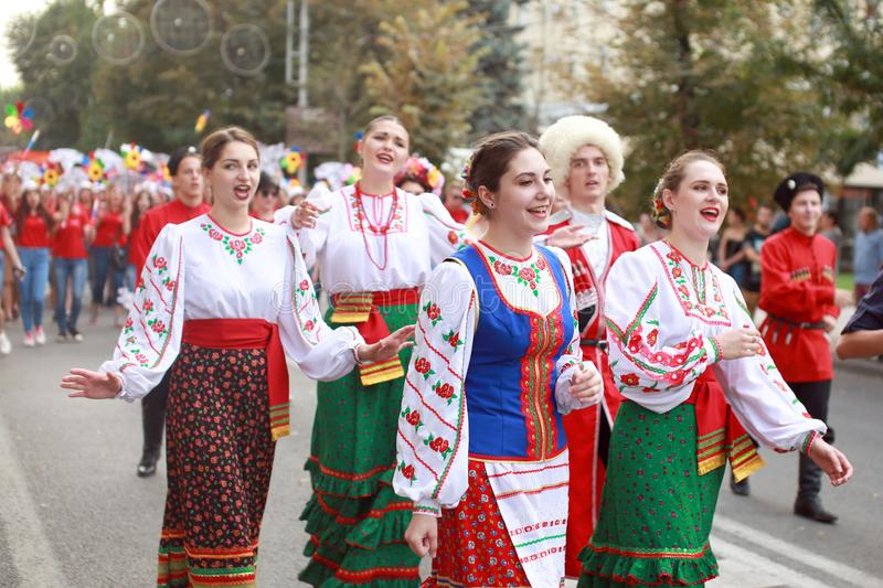 Procession of students of the Institute of culture, dancers in Cossack traditional dress, colored skirt, green trousers and maroon. Russia, Krasnodar 23.09.17 stock image