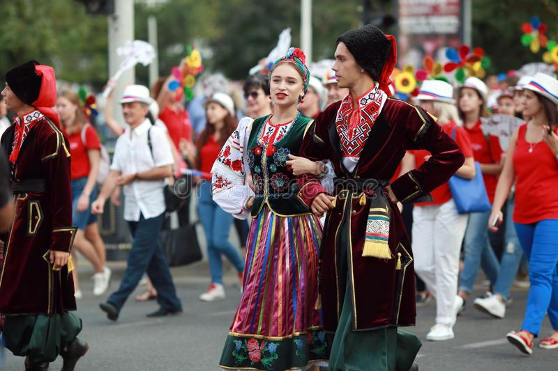 Procession of students of the Institute of culture, dancers in Cossack traditional dress, colored skirt, green trousers and maroon royalty free stock images