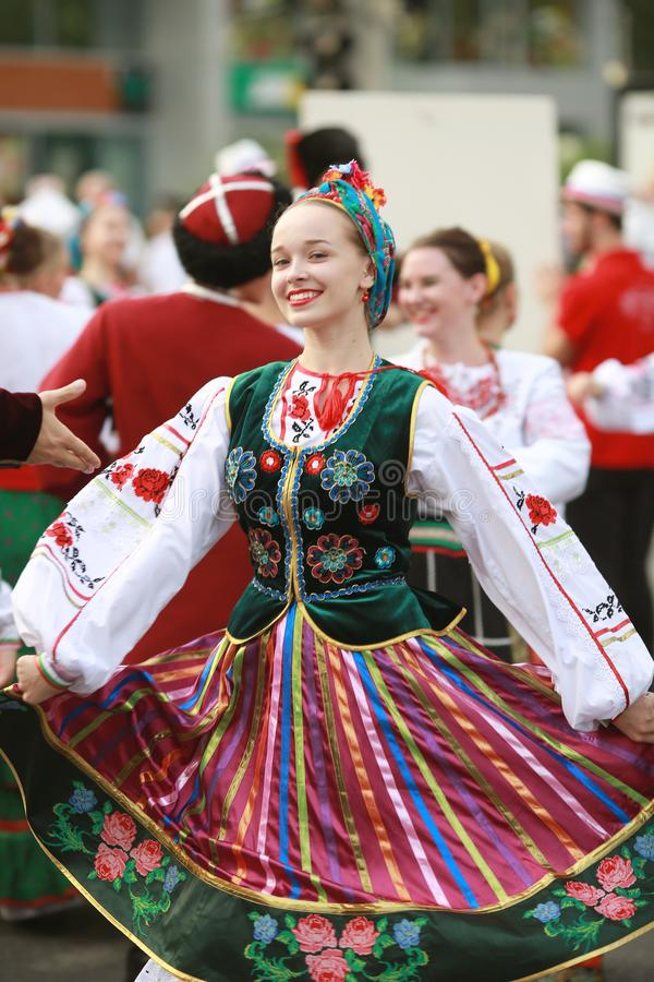 Procession of students of the Institute of culture, dancers in Cossack traditional dress, colored skirt, green trousers and maroon. Russia, Krasnodar 23.09.17 stock photos
