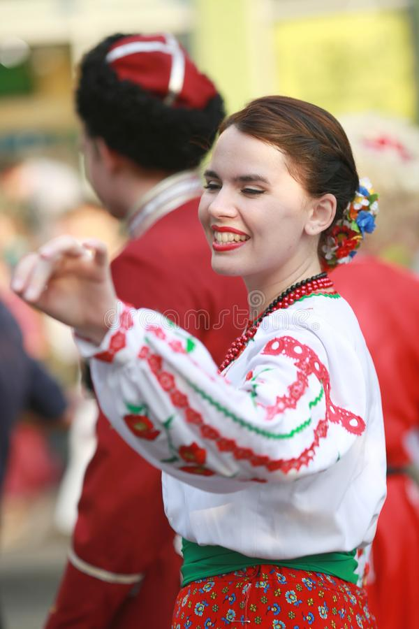 Procession of students of the Institute of culture, dancers in Cossack traditional dress, colored skirt, green trousers and maroon. Russia, Krasnodar 23.09.17 royalty free stock photography