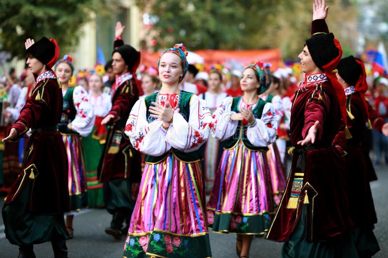 Procession of students of the Institute of culture, dancers in Cossack traditional dress, colored skirt, green trousers and maroon. Russia, Krasnodar 23.09.17 royalty free stock photo