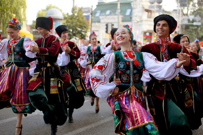 Procession of students of the Institute of culture, dancers in Cossack traditional dress, colored skirt, green trousers and maroon. Russia, Krasnodar 23.09.17 stock photo
