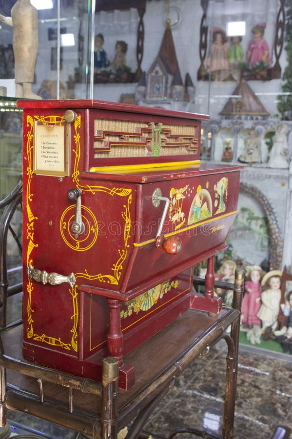 A barrel organ at a Christmas market. Russia, Krasnoyarsk, July 2019: A barrel organ at a Christmas market. wooden hurdy-gurdy stock image