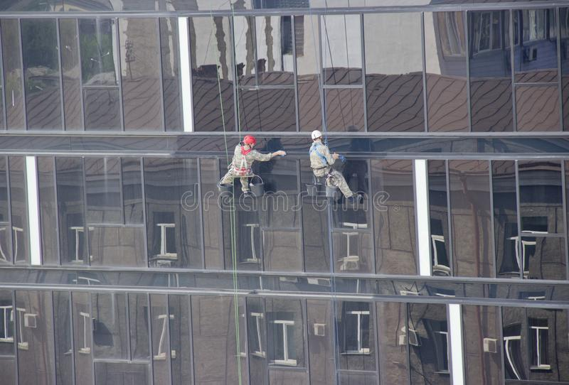industrial climbers clean windows stock image