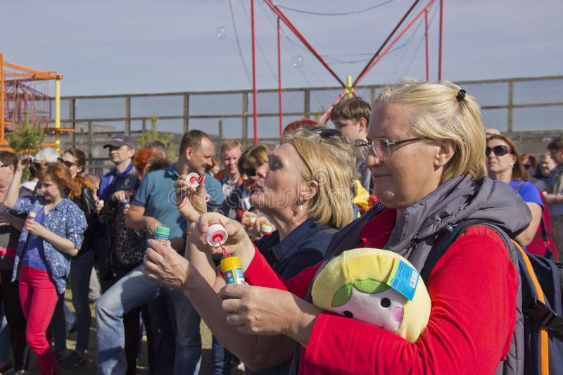 People on holiday blow bubbles royalty free stock image