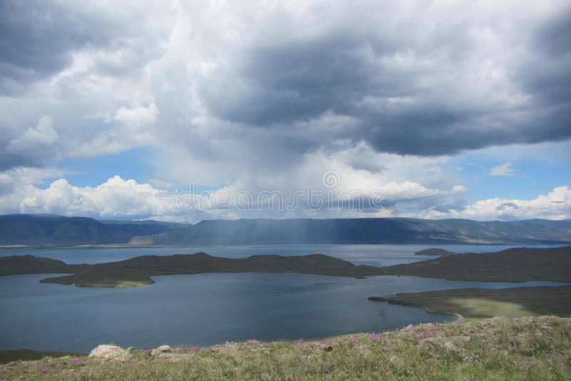 Russia lake Baikal island Olhon rain stock photos