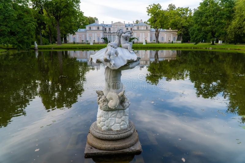 Museum Chinese Palace, a sculpture of a Triton in a Chinese pond in the summer. Russia. Lomonosov. Museum Chinese Palace, a sculpture of a Triton in a Chinese royalty free stock photography