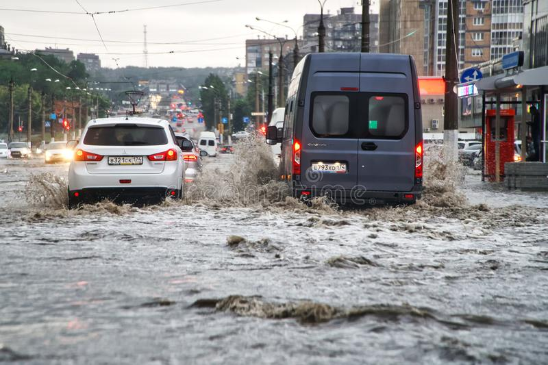 Russia, Magnitogorsk, August 13, 2019. The consequences of a hurricane rain on city streets. Flooding. The effects of global stock photos