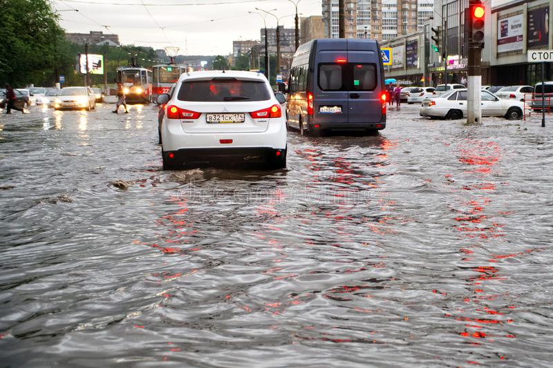 Russia, Magnitogorsk, August 13, 2019. The consequences of a storm in the city. Flooded streets. Cars in the water. The effects of stock photography