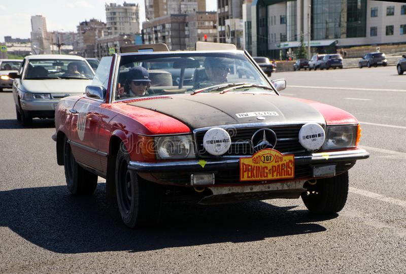 Russia, Magnitogorsk, - June, 20, 2019. Retro car Mercedes-Benz SL-Class - a red convertible on the streets of the city stock photography