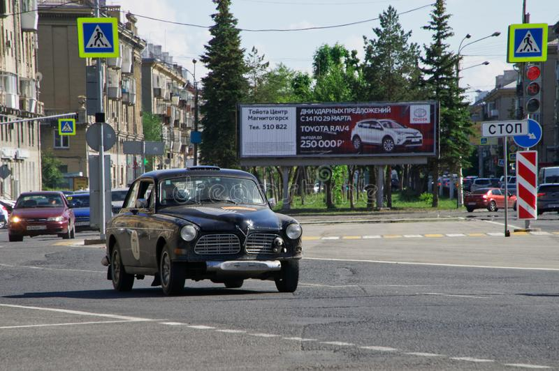 Russia, Magnitogorsk, - June, 20, 2019. Retro car Volvo Amazon 122S rides through the streets of the city on the background of royalty free stock photos