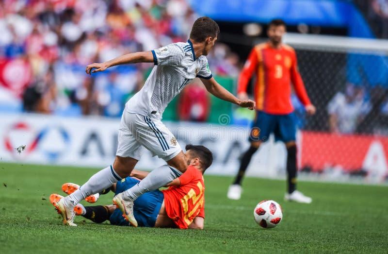 Russia midfielder Roman Zobnin against Spain national football team midfielder Marco Asensio. Moscow, Russia - July 1, 2018. Russia midfielder Roman Zobnin royalty free stock image