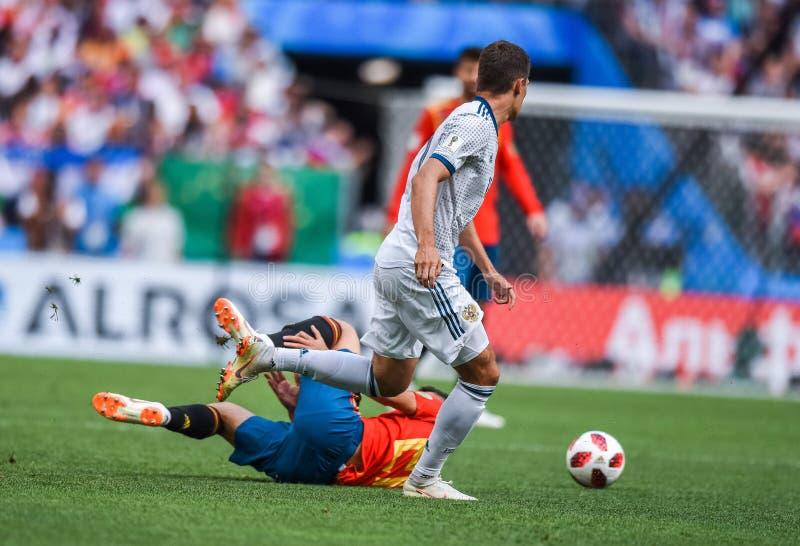 Russia midfielder Roman Zobnin against Spain national football team midfielder Marco Asensio. Moscow, Russia - July 1, 2018. Russia midfielder Roman Zobnin royalty free stock photo