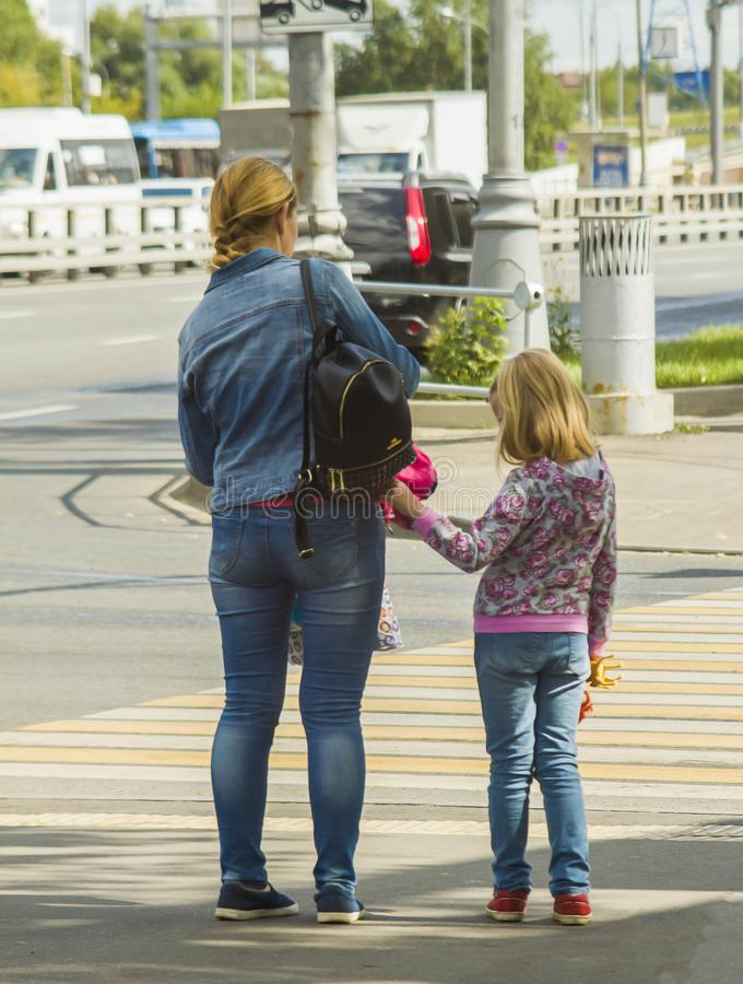 Mother and daughter are on the pedestrian crossing royalty free stock photos