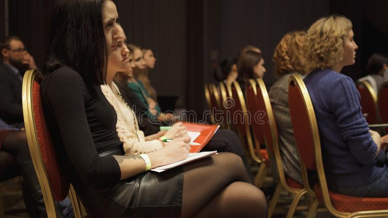 RUSSIA, MOSCOW - APRIL 13, 2019: Women`s audience listening to information trainings and lectures. Art. Women sitting in. Hall during speech about feminism, its royalty free stock images