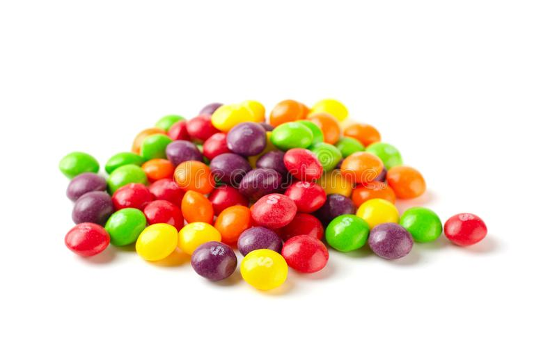Colorful skittles candies isolated on a white background. RUSSIA, MOSCOW - August 11, 2019: Colorful skittles candies isolated on a white background royalty free stock image
