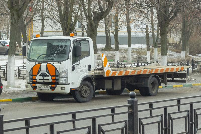 18-03-2019, Russia, Moscow, Creative design of a tow truck, car for help and evacuation of a broken vehicle, friendly face on the stock photography