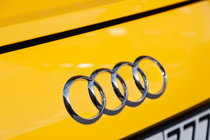 Russia Moscow 2019-06-17 The emblem on the back of Audi TT S Line brand logo on yellow car. Russia Moscow 2019-06-17 The emblem on the back of a Audi TT S Line stock photos