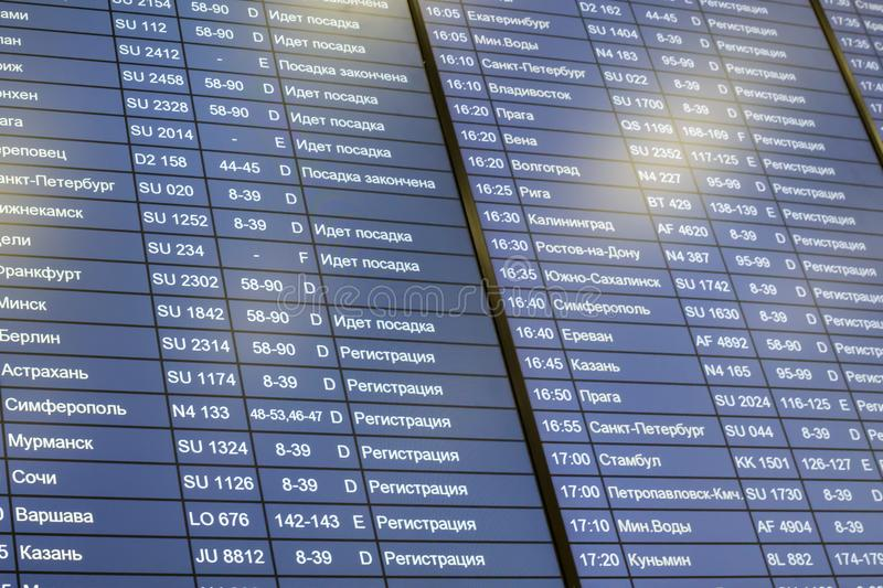 Russia, Moscow, Flight timetable. Russia, Moscow, 12.01.2018: Flight timetable Sheremetyevo International Airport. Close-up, Full frame, background. Blue screen stock photography