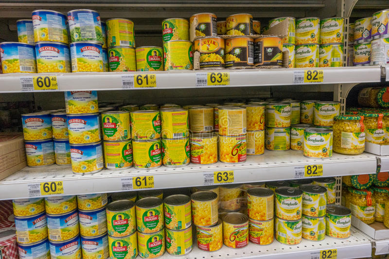 RUSSIA, MOSCOW, JUNE 11, 2017: Different types of canned corn on the shelves in the supermarket Auchan royalty free stock images