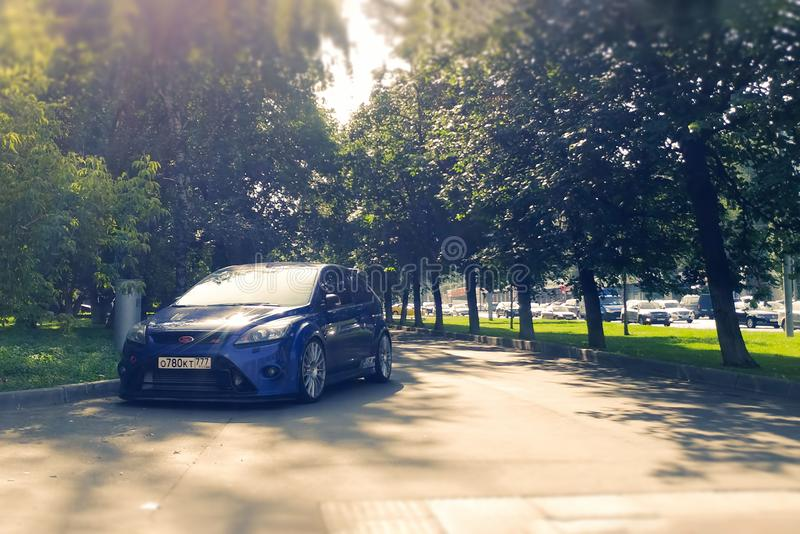 Russia, Moscow - May 04, 2019: Blue hot hatchback Ford Focus RS Parked on the sidewalk. Violates parking rules. Racing car on the. Walking road hothatch stock photography