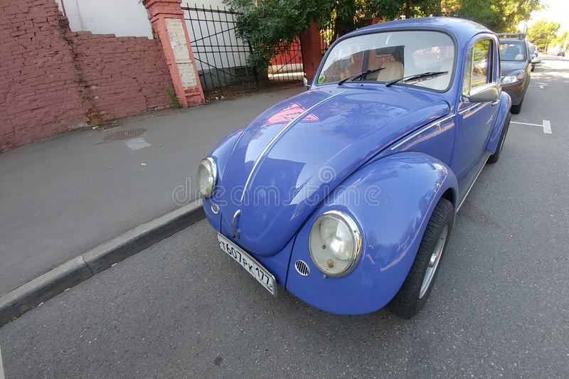 Russia, Moscow - May 04, 2019: Blue Vintage car Volkswagen Beetle  Volkswagen Bug, VW Kaefer parked on the street. Front side. View royalty free stock image