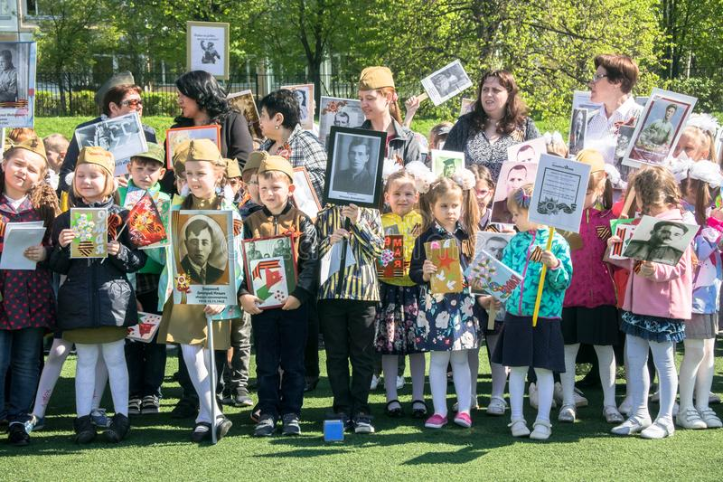 Russia. Moscow, May,07.18: Special kindergarten procession of the Immortal regiment, military state propaganda for russian kids. stock photo