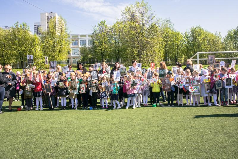 Russia. Moscow, May,07.18: Special public kindergarten action `Immortal regiment`, military state propaganda for russian kids. Special procession of the stock photo