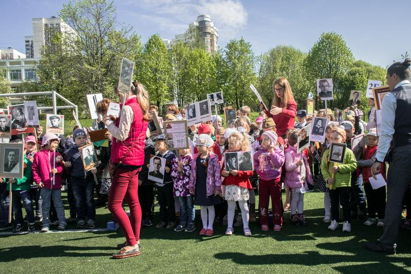 Russia. Moscow, May,07.18: Special public kindergarten action `Immortal regiment`, military state propaganda for russian kids. Special procession of the royalty free stock images