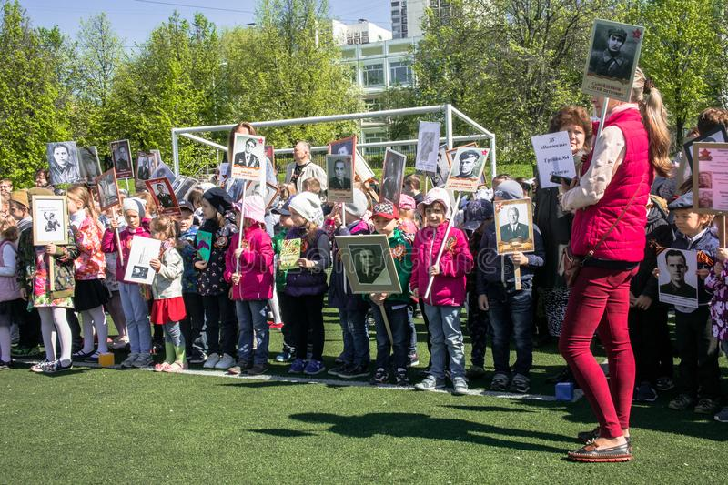 Russia. Moscow, May,07.18: Special public kindergarten action `Immortal regiment`, military state propaganda for russian kids. Special procession of the stock images