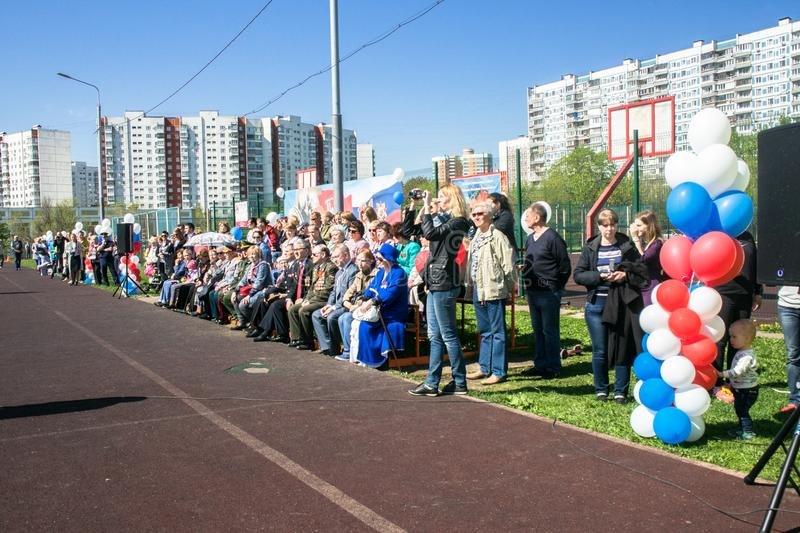 Russia. Moscow, May,07.18: Viewers at the crowded school stadium on the special public kindergarten action `Immortal regiment`. Viewers at the crowded school stock photography