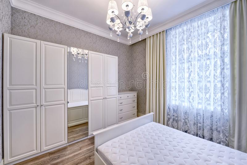Interior design beautiful bedroom in luxury home. Russia, Moscow - modern designer renovation in a luxury building. Stylish bedroom interior with double bed royalty free stock image